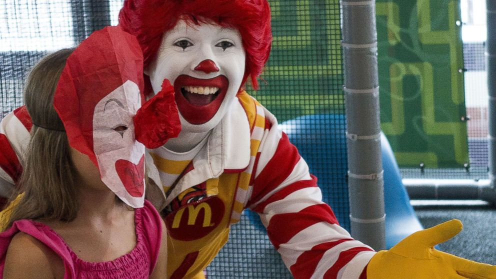 A person dressed as Ronald McDonald entertains a young girl during his appearance at a McDonalds's Aug. 10, 2015, in Centreville, Va.