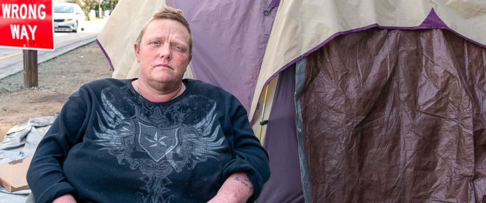 PHOTO: Jennifer Millar lives in a tent with her two dogs under a Hollywood freeway ramp. Millar says she keeps trash bags and hand sanitizer near her tent, and she regularly pours water mixed with hydrogen peroxide on the sidewalk.