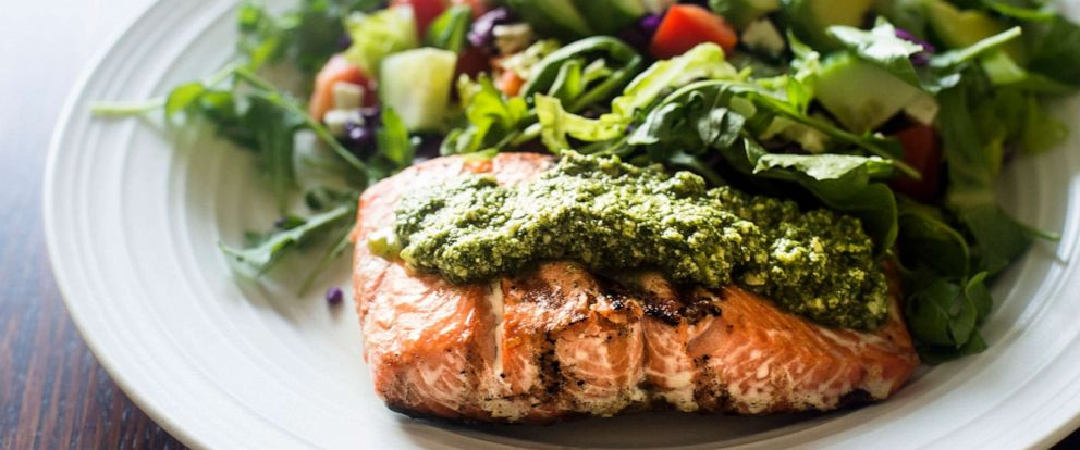 PHOTO: This stock photo depicts a filet of salmon with pesto and a side salad.