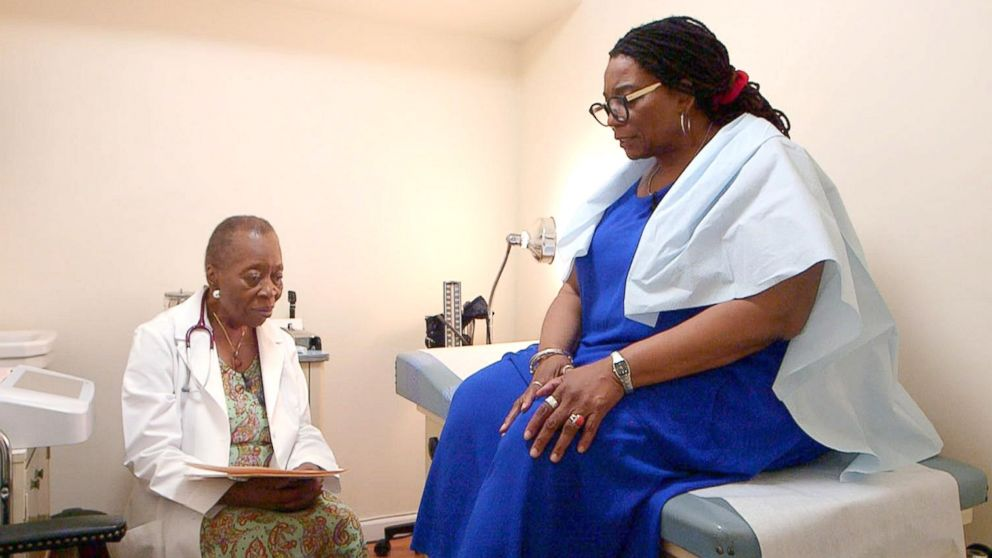 Dr. Melissa Freeman speaks with a patient at her private practice in Harlem, New York.