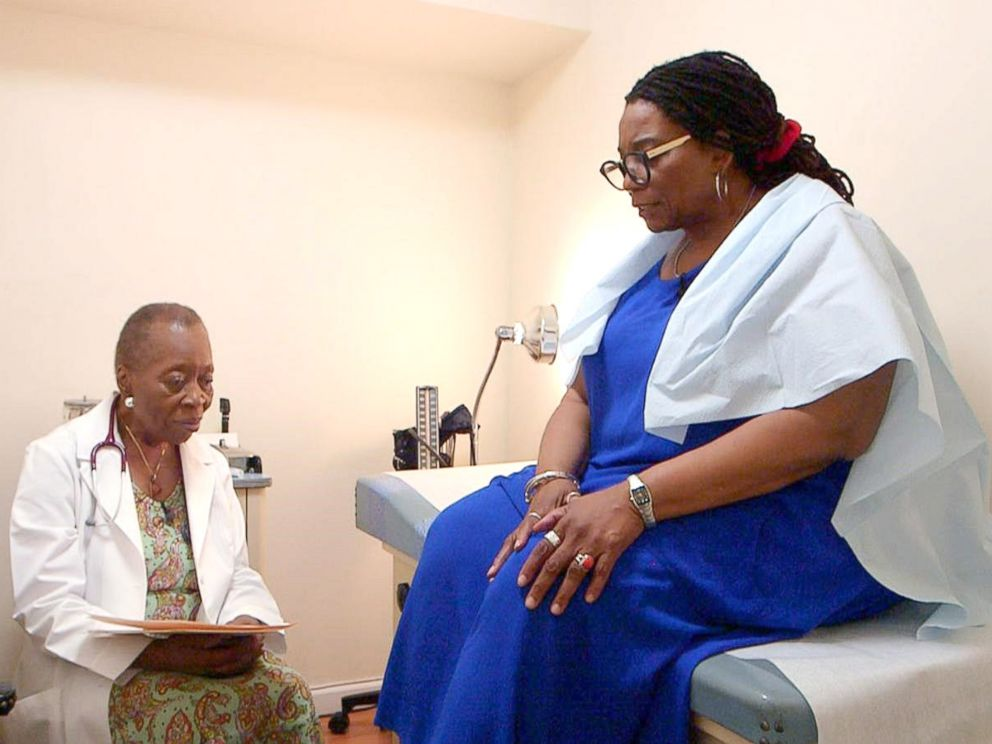 PHOTO: Dr. Melissa Freeman speaks with a patient at her private practice in Harlem, New York.