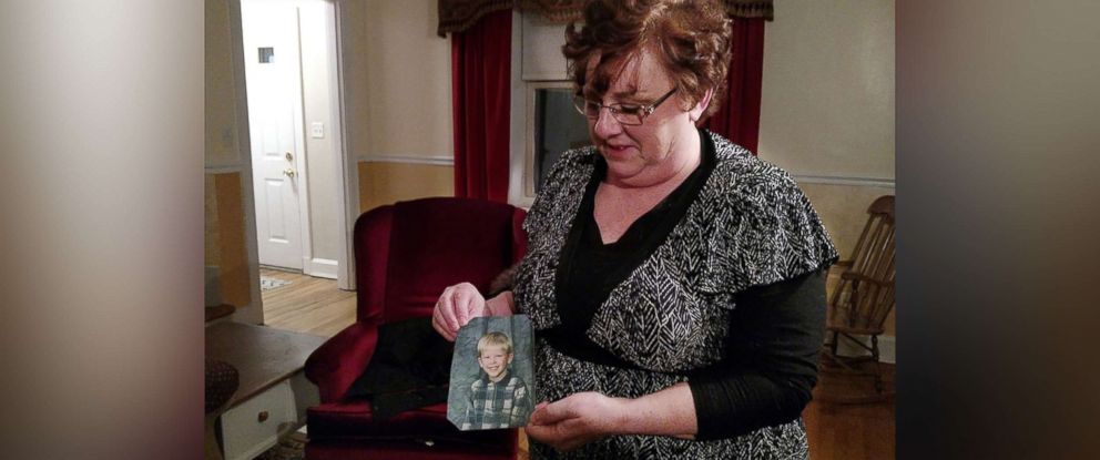 PHOTO: Toni Hoy, at her home in Rantoul, Ill., holds a childhood photo of her son, Daniel, who is now 24. In a last-ditch effort to get Daniel treatment for his severe mental illness in 2007, the Hoys surrendered parental custody to the state.