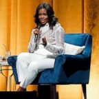 Former first lady Michelle Obama speaks at the opening of her multi-city book tour at the United Center in Chicago, Nov. 13, 2018.