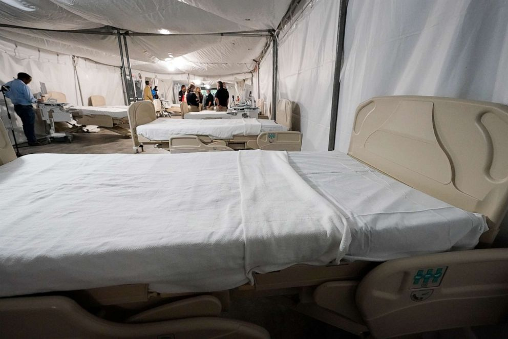 PHOTO: Beds await patients in the completed section of a COVID-19 mobile field hospital erected in a parking garage at the University of Mississippi Medical Center in Jackson, Miss., Thursday, Aug. 12, 2021.