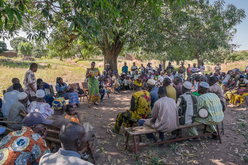 Villagers in Burkina Faso receive information regarding the release of genetically modified mosquitoes being tested to help fight malaria.