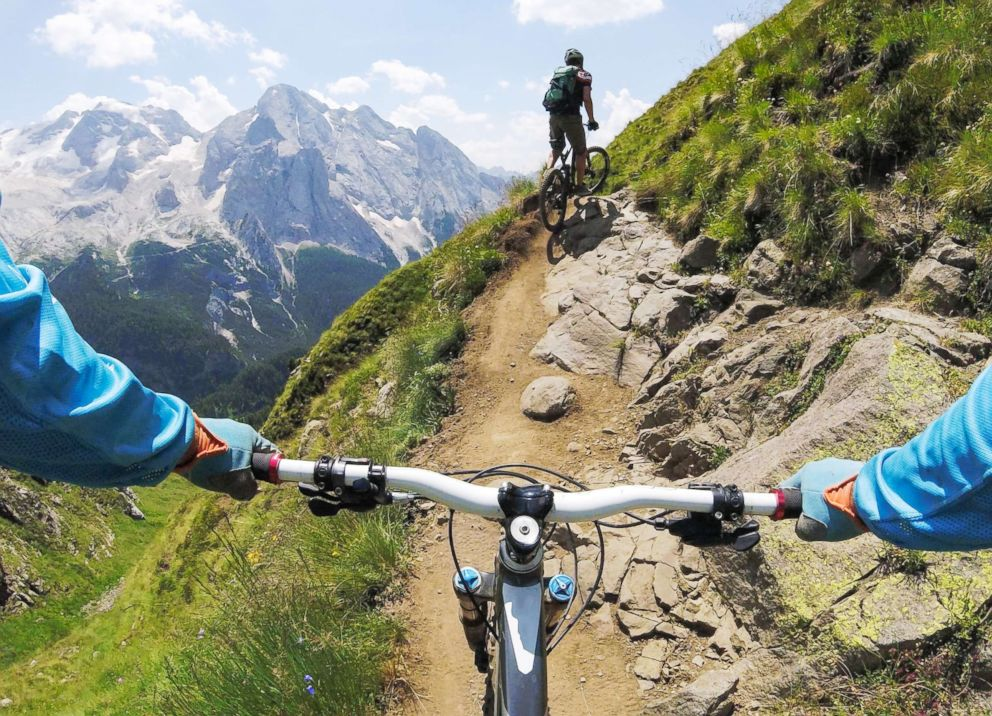 PHOTO: Two men mountain bike in Dolomites, Italy, in this undated stock photo.