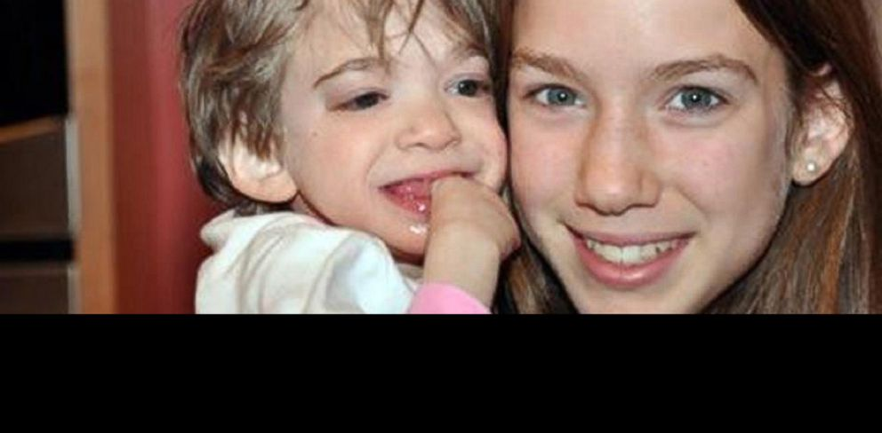 PHOTO: Brooke Greenberg, 16, left, is held by younger sister Carly, 13, in this May 11, 2010 photo.