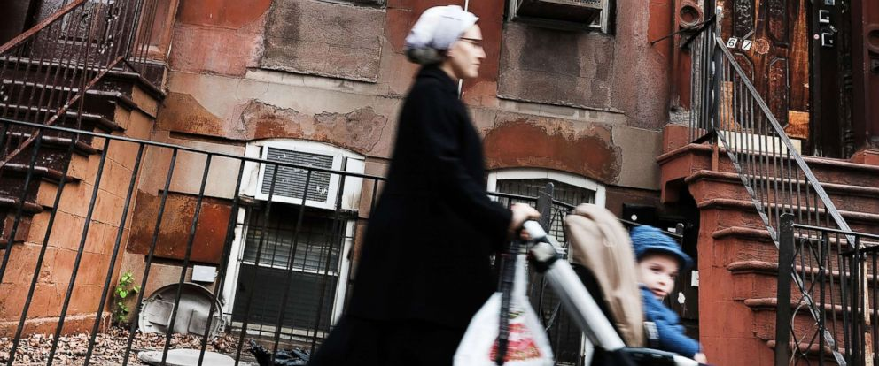 PHOTO: A Hasidic woman walks through a Jewish Orthodox neighborhood in Brooklyn on April 24, 2017, in New York City.