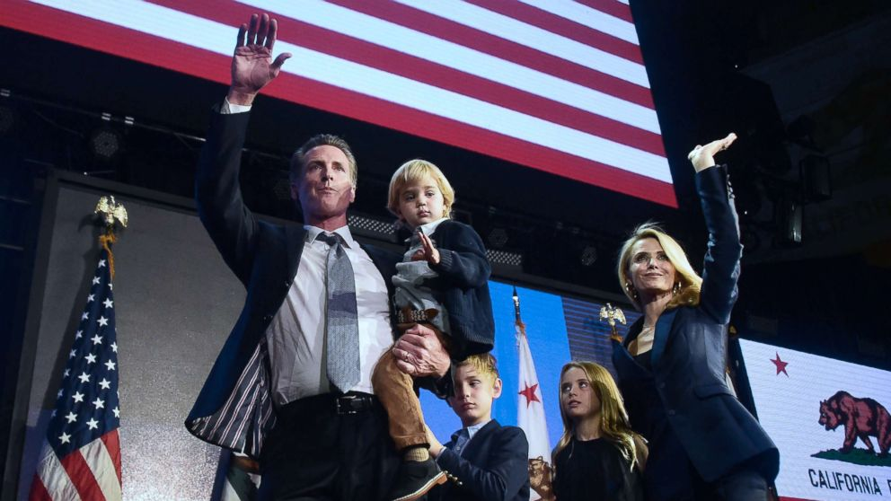 California's Democratic gubernatorial candidate Gavin Newsom and his family wave to supporters from the stage at his election night watch party in Los Angeles, Nov, 6, 2018.