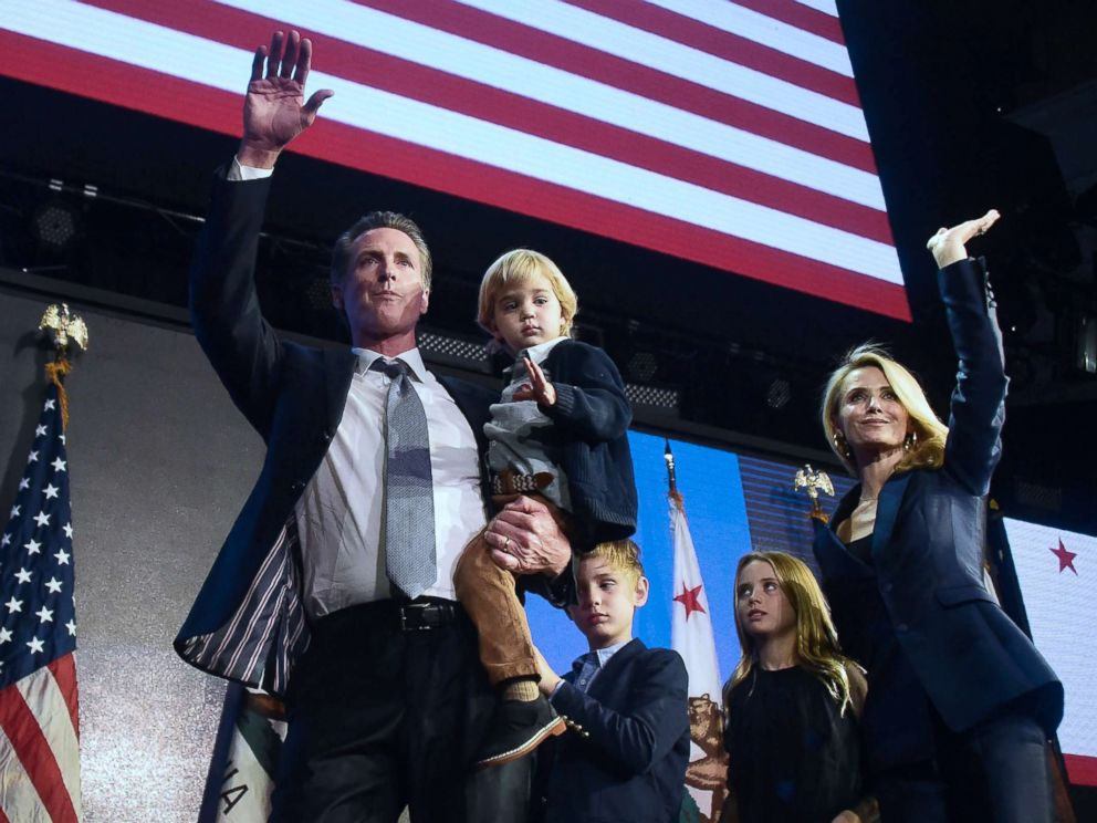 PHOTO: Californias Democratic gubernatorial candidate Gavin Newsom and his family wave to supporters from the stage at his election night watch party in Los Angeles, Nov, 6, 2018.