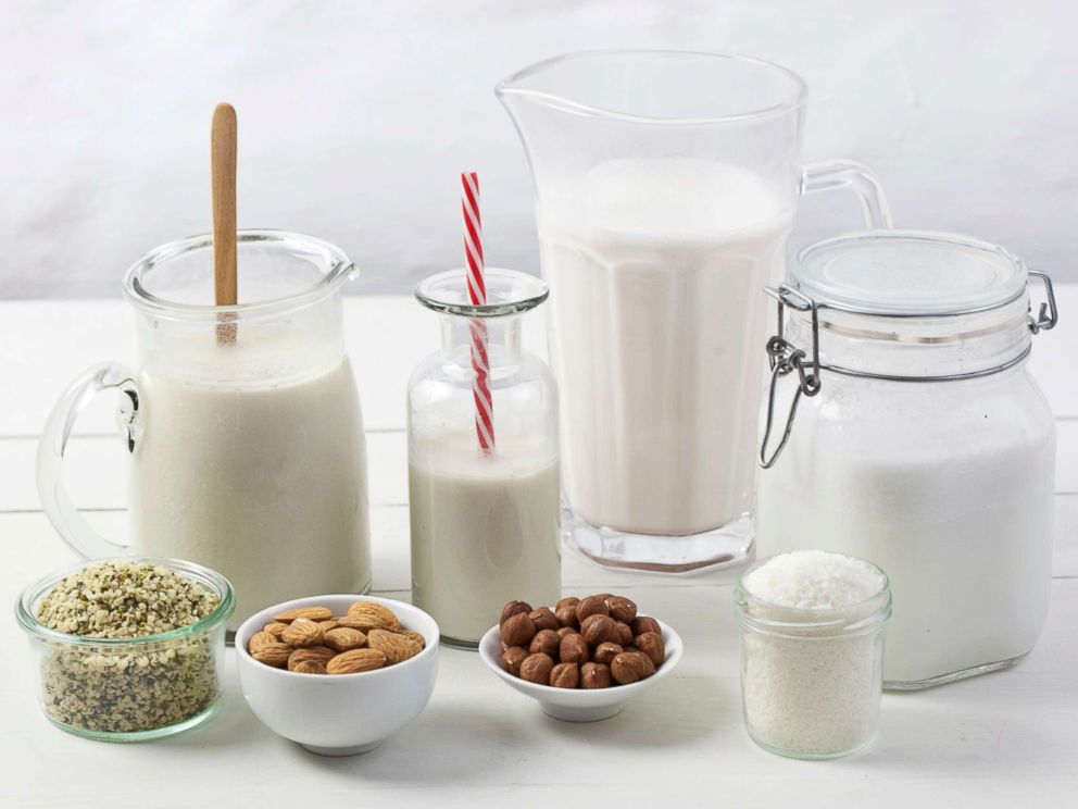 PHOTO: Various types of vegan milk with ingredients.