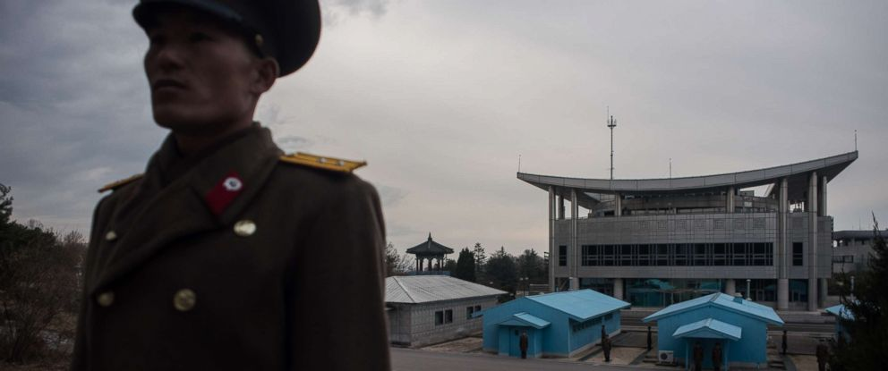 PHOTO: A Korean Peoples Army soldier stands before the joint security area and Demilitarized Zone (DMZ) separating North and South Korea, in Panmunjom, Nov. 30, 2016.