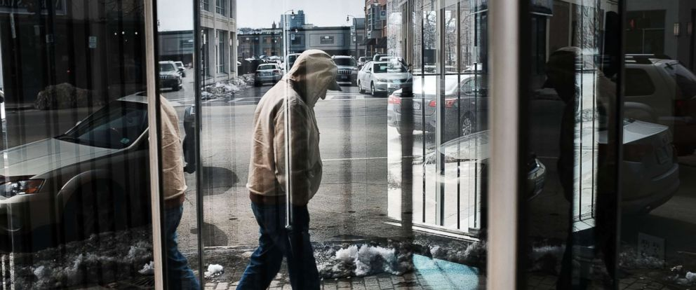 PHOTO: A man walks through an economically stressed section of the city on March 20, 2018 in Worcester, Mass. Like a growing number of Northeastern cities, Worcester has a chronic problem with homelessness and opioid addiction.