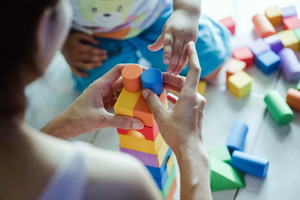 PHOTO: This stock photo depicts a mother using building blocks with her child.