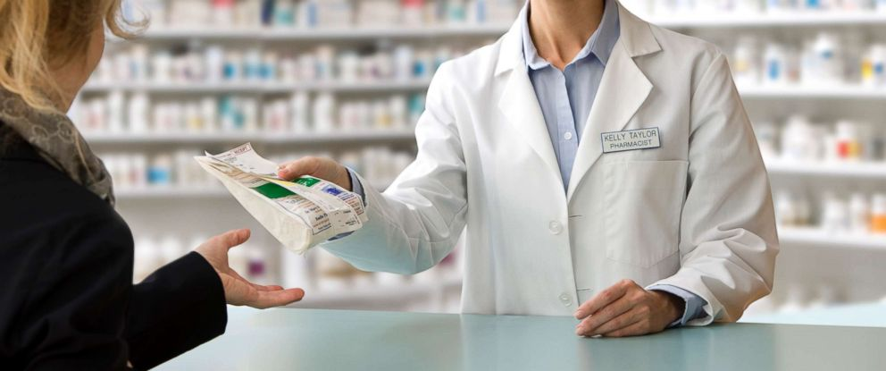 PHOTO: A pharmacist delivers a customers prescription in this stock photo.