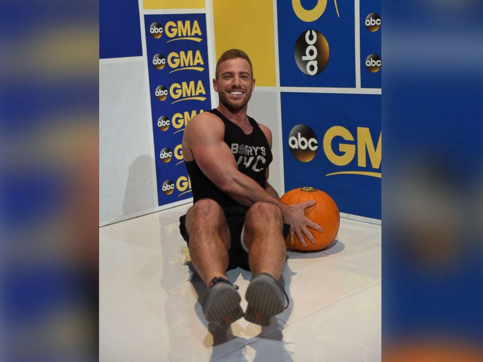 PHOTO: Barrys Bootcamp trainer Josey Greenwell demonstrates the pumpkin seated Russian twist.