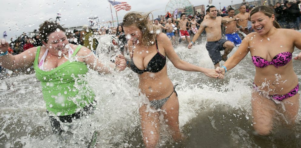 PHOTO: People enter the water while taking part in the Coney Island Polar Bear Clubs annual New Years Day Polar Bear Swim in New York, Jan. 1, 2013.