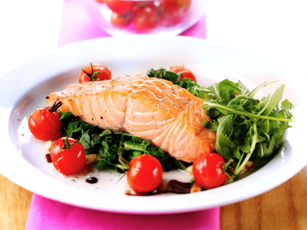 PHOTO: Salmon is served on a bed of spinach in this undated stock photo.