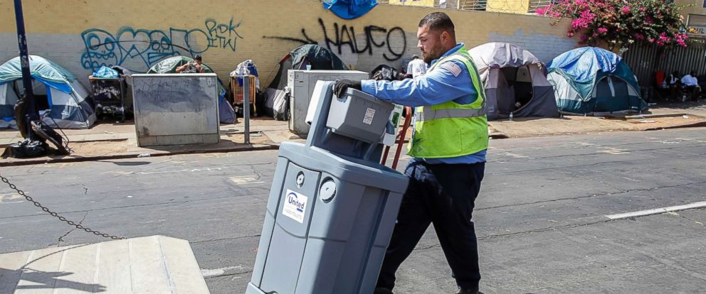 PHOTO: A United Site Services worker delivers a 2-station sink to the Neil Good Day Center on 17th Street downtown San Diego, Calif., Sept. 1, 2017.