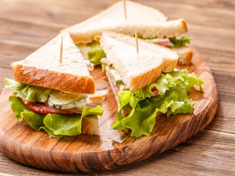 PHOTO: Sandwich triangles held together with toothpicks sit on a cutting board in an undated stock photo.