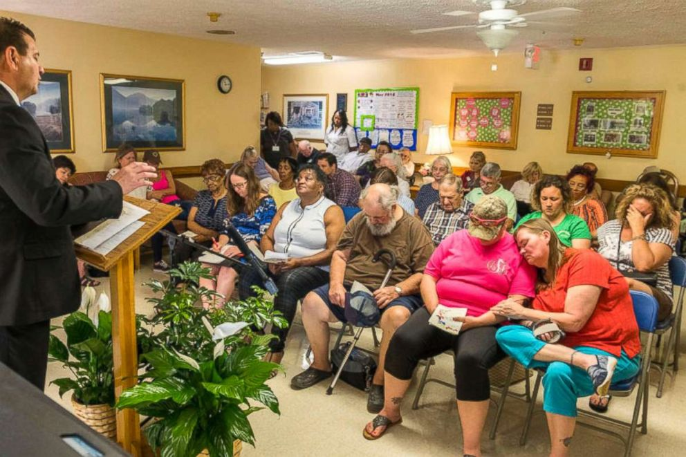 PHOTO: Those mourning former nursing home residents pray together near the end of an annual bereavement ceremony at Gray Health & Rehabilitation in Gray, Ga., on May 14, 2018.