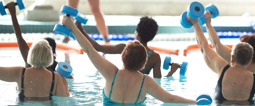 PHOTO: A group of adults take a water aerobics class together in this undated stock photo.