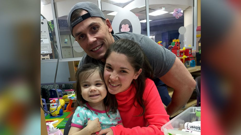 Shelby and Jonathan Skiles pose with their 2-year-old daughter Sophie who was diagnosed with T-cell lymphoma in May.