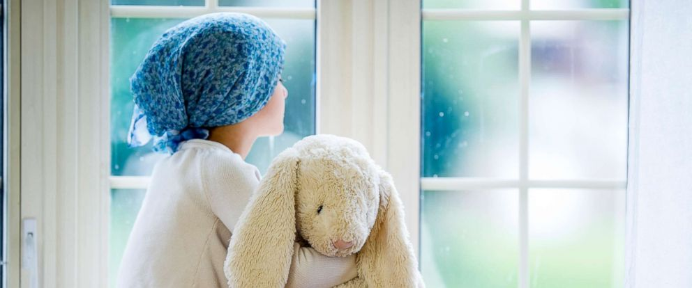 PHOTO: This stock photo depicts a young cancer patient looking out the window.