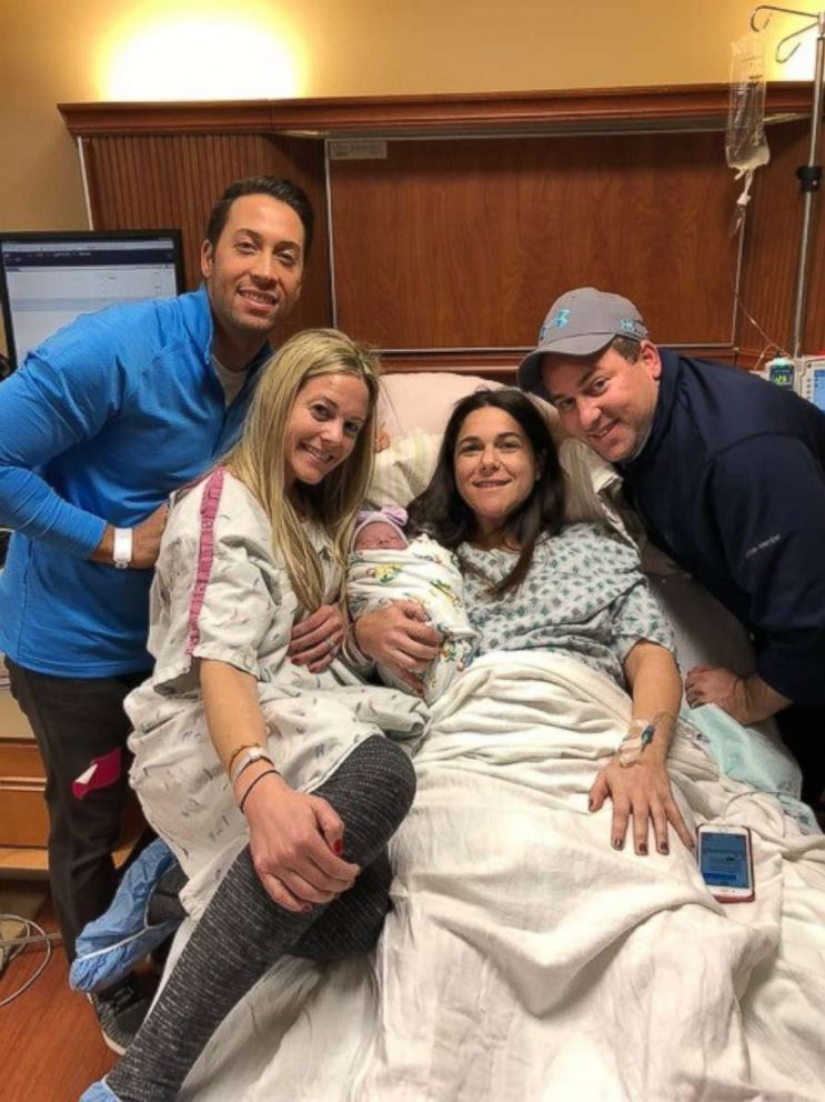 PHOTO: Erin Silverman, center, poses with her husband, sister and brother-in-law after giving birth to Austyn.