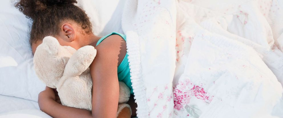 PHOTO: A child sleeps with her teddy bear in this undated stock photo.