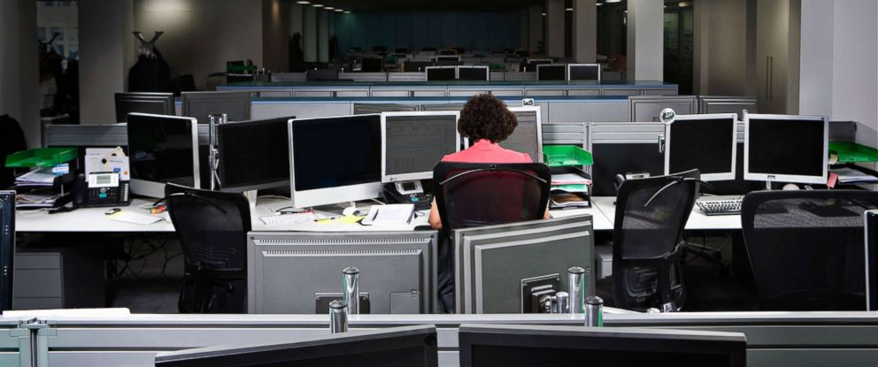 PHOTO: A woman works alone in an office, in a stock photo.