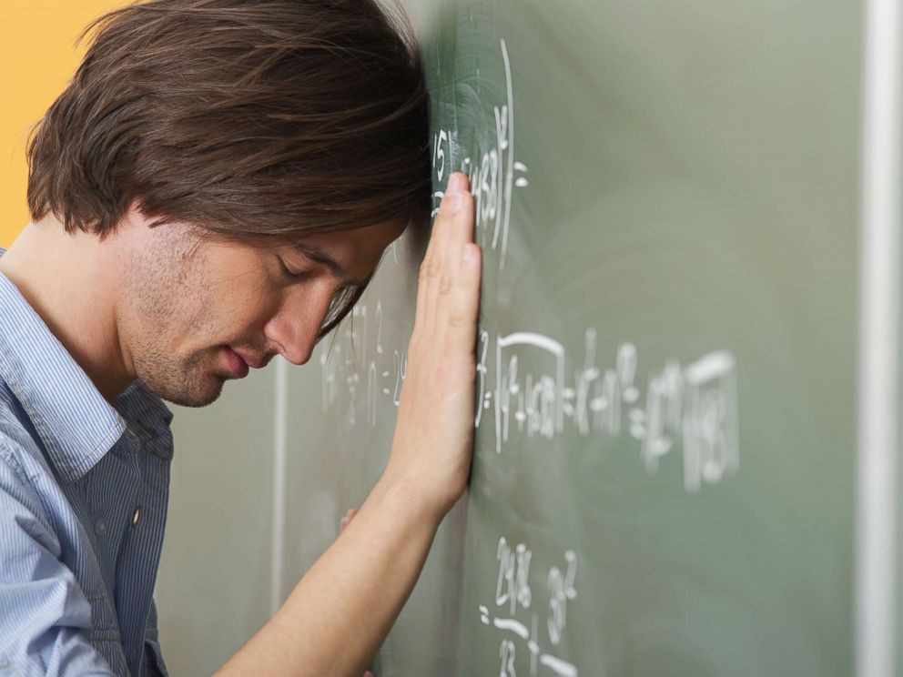 PHOTO: A college student is pictured leaning his head against a blackboard in this undated stock photo