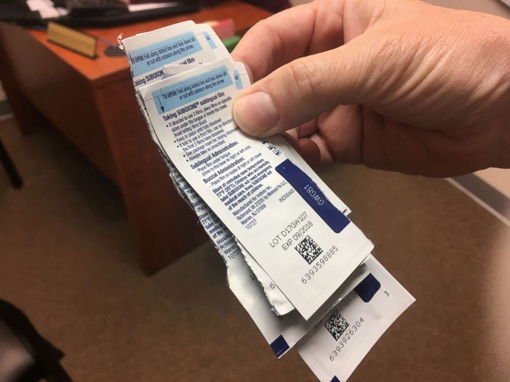 PHOTO: Staff at CleanSlate, an addiction treatment center in Anderson, Ind., count patients Suboxone wrappers to make sure they adhere to their buprenorphine regimen.