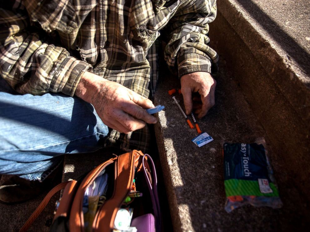 PHOTO: Daryl, who has had an opioid use disorder for more than a decade, prepares to inject Suboxone he bought on the street. He said it helped him remember what being normal felt like.