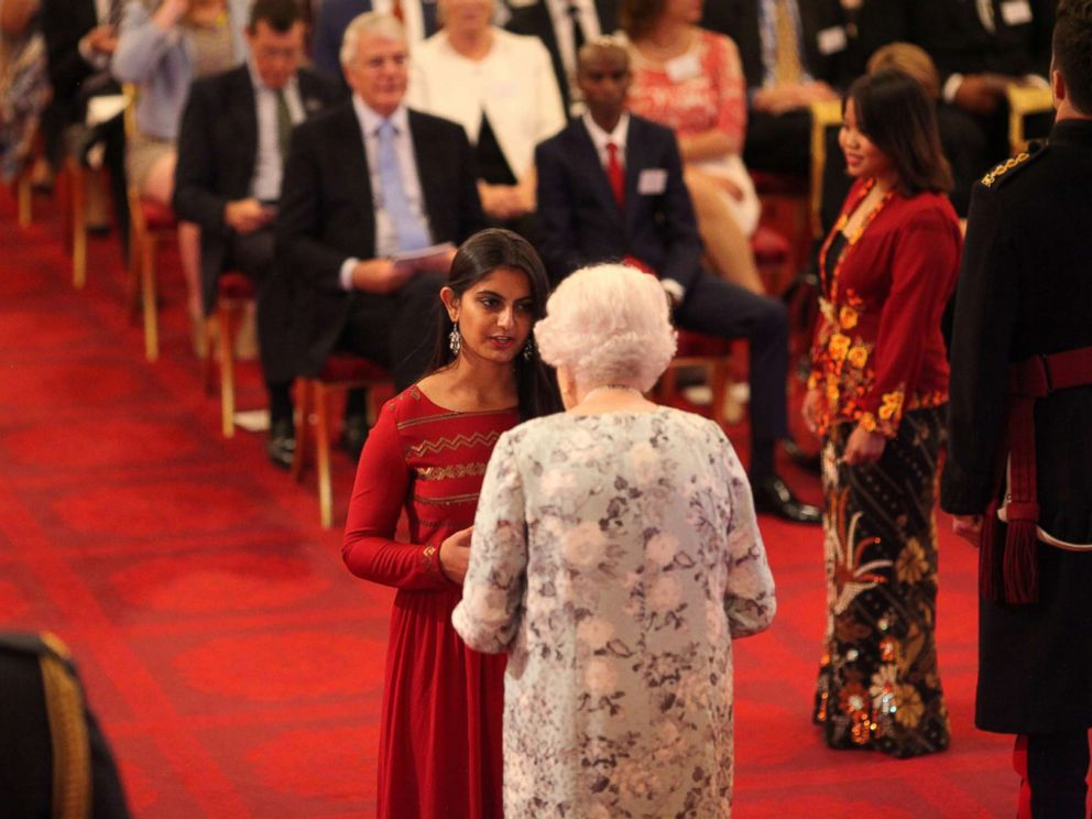 PHOTO: Suhani Jalota from India receives a Queens Young Leaders Award for 2017 from Queen Elizabeth II at the 2017 Queens Young Leaders Awards Ceremony at Buckingham Palace on June 29, 2017 in London.