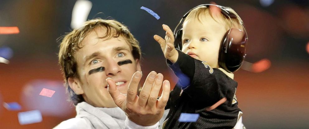 PHOTO: New Orleans Saints quarterback Drew Brees celebrates with his son Baylen in the confetti-filled air following Super Bowl XLIV at Sun Life Stadium in Miami Gardens, Fla. Brees son is wearing protective earmuffs.
