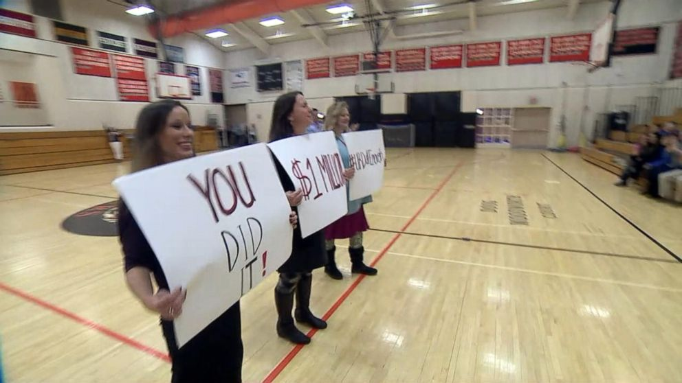 PHOTO: The teachers at Ipswich Middle School share the good news with their sixth-grade students: Their viral video helped raise $1 million for classmate Talia Duffs foundation.