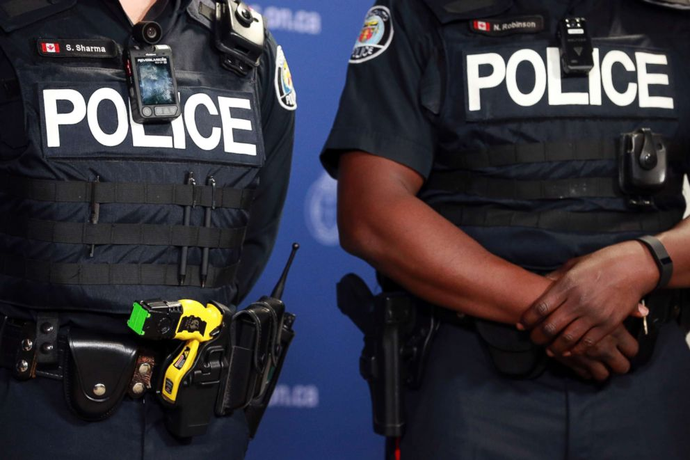 PHOTO: Taser and camera wore by police officer during a press conference introducing new body-worn police video cameras, May 15, 2015.