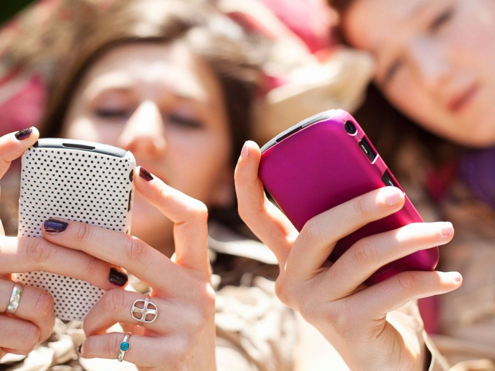 PHOTO: Young women use their phones in this undated stock photo.