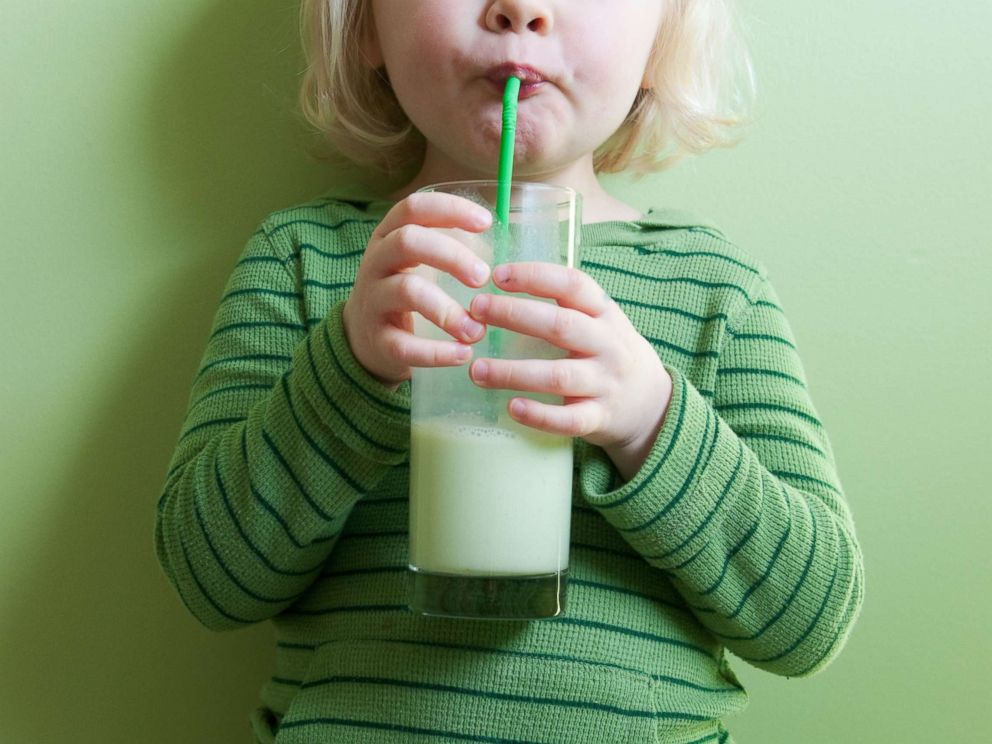 PHOTO: A toddler girl sips a drink through a straw in this undated stock photo.