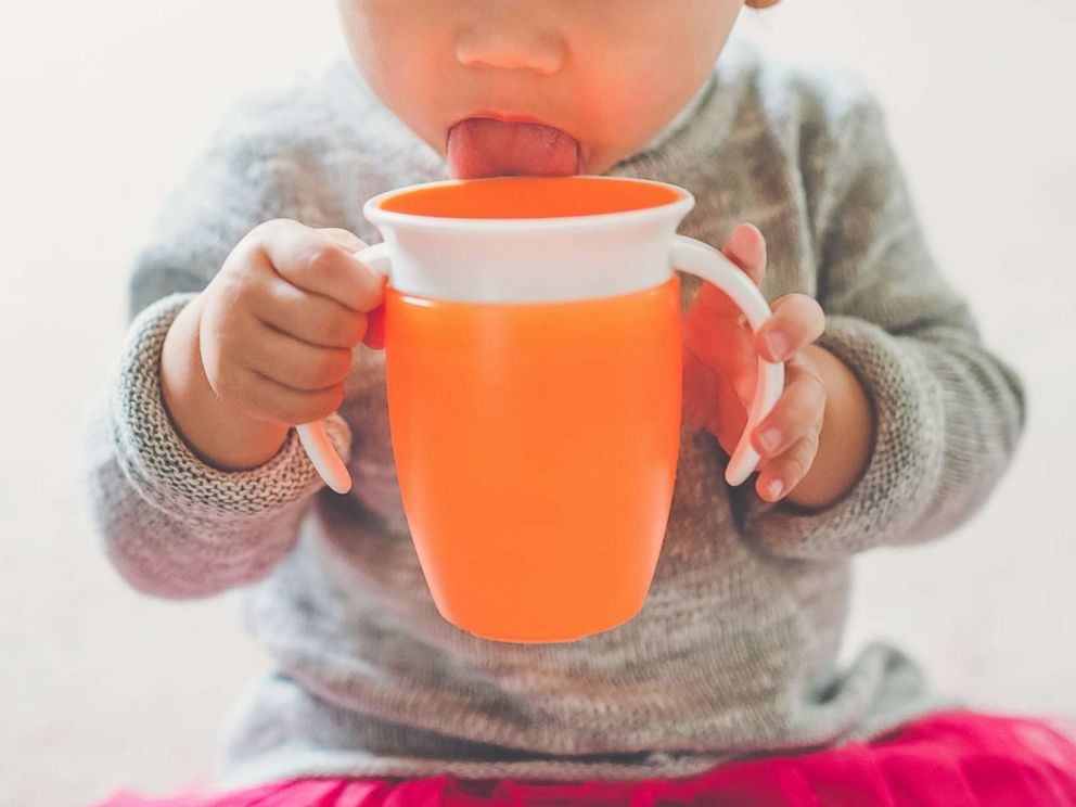PHOTO: A toddler girl drinks from her sippy cup in this undated stock photo.