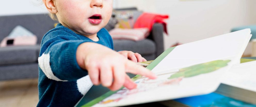 PHOTO: An undated stock photo of a toddler with a book.