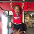 Jaymari Williams, 1, tries out training equipment.
