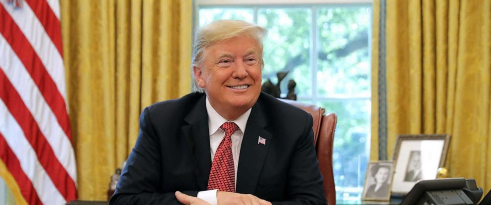 PHOTO: In this Oct. 17, 2018, file photo, President Donald Trump talks to reporters while hosting workers and members of his cabinet for a meeting in the Oval Office at the White House in Washington, DC.