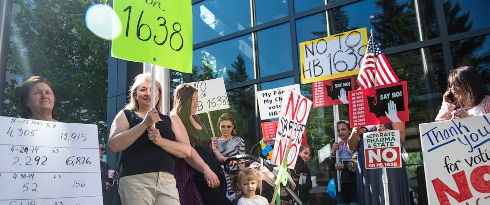 PHOTO: A group of anti-vaccine protesters gather in front of Vancouver City Hall prior to the signing of HB 1638 in Vancouver Wash., on May 10, 2019.