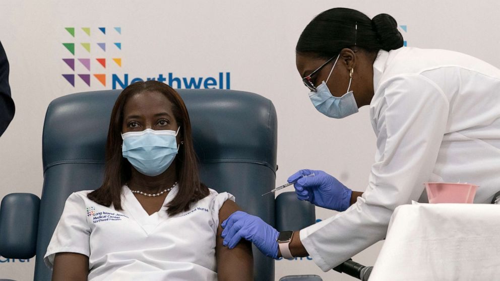 PHOTO: Sandra Lindsay, left, a nurse at Long Island Jewish Medical Center, is inoculated with the Pfizer-BioNTech COVID-19 vaccine by Dr. Michelle Chester, Dec. 14, 2020, in New York.