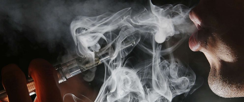PHOTO: In this photo illustration, a man smokes an E-Cigarette in Covent Garden, Aug. 27, 2014, in London.