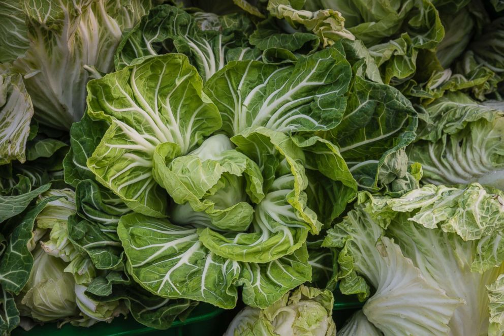 PHOTO: Cabbage plants on display at a vegetables stall in the local municipal market, December 2, 2017 in Matosinhos, Portugal.