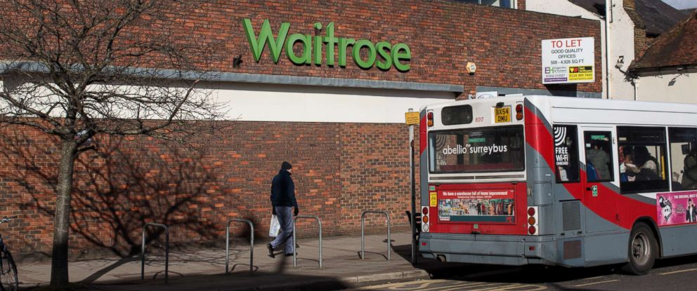 PHOTO: A Surrey local bus stands at a bus stop in front of a Waitrose supermarket, Feb. 12, 2018 in Weybridge, England.