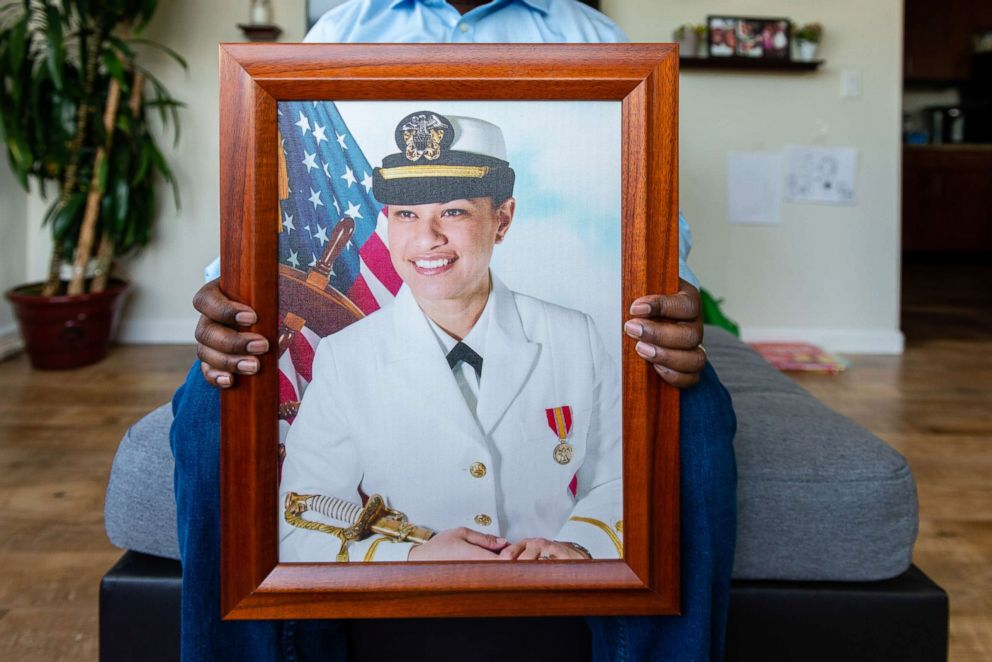 """Walter Daniel, a former Coast Guard officer, holds a photograph of his wife, Navy Lt. Rebekah Daniel, known as """"Moani."""" She died hours after giving birth to their daughter, Victoria, at the Naval Hospital Bremerton. Daniel says he received no details about how the low-risk pregnancy of his healthy 33-year-old wife, a labor and delivery nurse, ended in tragedy."""